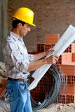 Architect looking at blueprints Stock Photo