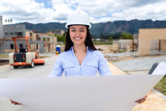 Architect looking at blueprints Royalty Free Stock Photo