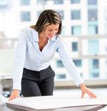 Architect looking at blueprints Royalty Free Stock Photography
