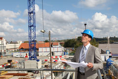 Architect looking at construction plan Royalty Free Stock Photo