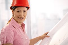 Architect looking at floor plan Stock Photography