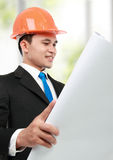 Architect looking at paper print in the office Royalty Free Stock Images