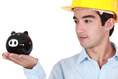 Architect looking at piggy bank Stock Photo