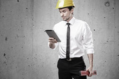 Architect looking at a touchpad Stock Image
