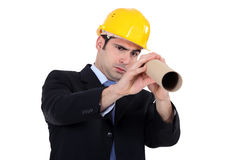 Architect looking through tube Royalty Free Stock Image