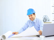 Architect looking working in office at desk. Stock Images