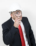 Architect with magnifier Stock Photography