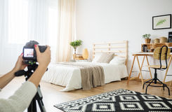 Architect making a photo of interior arrangement. In eco style stock photos