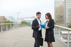 Architect male and contractor female discuss details of contr royalty free stock photo