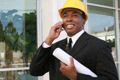 Architect Man. A young man working as an architect on a building site Stock Photo