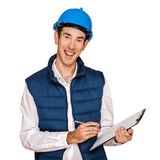 Architect man, blue helmet, isolated over white background. Stock Image