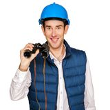 Architect man isolated over white background with binoculars. Royalty Free Stock Photos