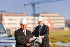Architect man make notes on construction site Stock Photography