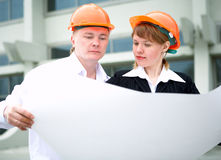 Architect man and woman in helmet Royalty Free Stock Photography
