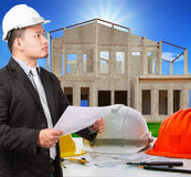 Architect man and working ducument plan in house construction si Stock Photos