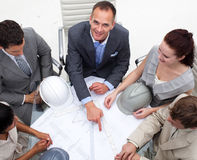 Architect manager pointing at a blueprint Royalty Free Stock Photos