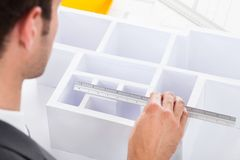 Architect Measuring House Model Stock Photography