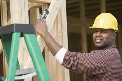 Architect Measuring Level Of Wooden Beam Stock Image