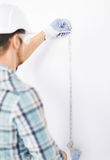 Architect measuring wall with flexible ruler Royalty Free Stock Image