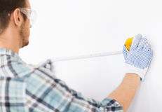 Architect measuring wall with flexible ruler royalty free stock images
