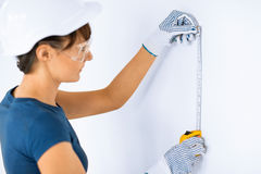 Architect measuring wall with flexible ruller Stock Image