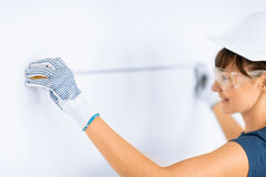 Architect measuring wall with flexible ruller Stock Images