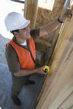 Architect Measuring Wooden Beam Stock Images