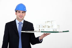 Architect with model in hand Stock Photography