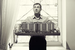 Architect with model  residential building Royalty Free Stock Image