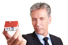 Architect offering a house Royalty Free Stock Images