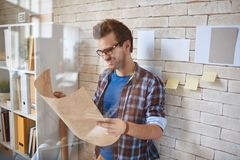 Architect by office wall Royalty Free Stock Image