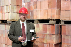 An architect with pallets of bricks Stock Photo