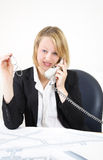 Architect on the phone. A office women on her office speaking on the phone Royalty Free Stock Images