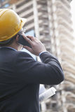 Architect on the phone at a construction site Stock Image