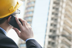 Architect on the phone at a construction site Royalty Free Stock Photos
