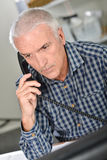 Architect on phone to client Royalty Free Stock Images