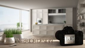 Architect photographer designer desktop concept, camera on wooden work desk with screen showing interior design project, blurred. Scene in the background royalty free illustration