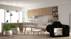 Architect photographer designer desktop concept, camera on wooden work desk with screen showing interior design project, blurred. Scene in the background royalty free stock image