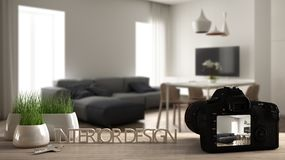 Architect photographer designer desktop concept, camera on wooden work desk with screen showing interior design project, blurred. Scene background, modern royalty free stock photo