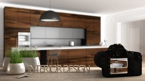 Architect photographer designer desktop concept, camera on wooden work desk with screen showing interior design project, blurred. Scene in the background stock photography