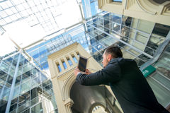 Architect photographing your project. Successful businessman in Stock Photography