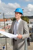 Architect with plan on building site Royalty Free Stock Photography