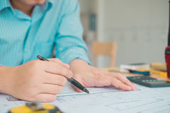 Architect or planner working on drawings for construction plans Royalty Free Stock Photos