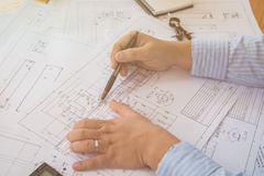 Architect or planner working on drawings for construction plans Stock Image