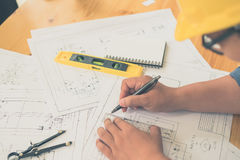 Architect or planner working on drawings for construction Stock Photos