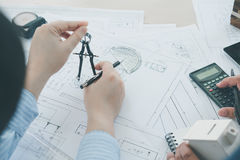 Architect or planner working on drawings for construction Royalty Free Stock Photos