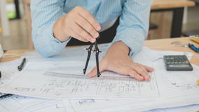 Architect or planner working on drawings for construction plans Royalty Free Stock Image