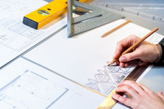 Architect planning home layout. Stock Photos