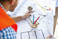 Architect Planning And Looking At A Blueprint Stock Photo