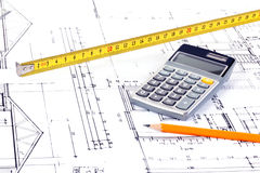 Architect plans. Desk of an architect with plan, pencil, tape measure and calculator Royalty Free Stock Photos
